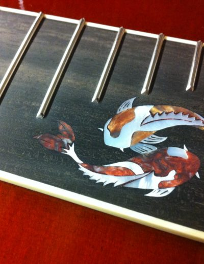 Diminished frets with custom inlay