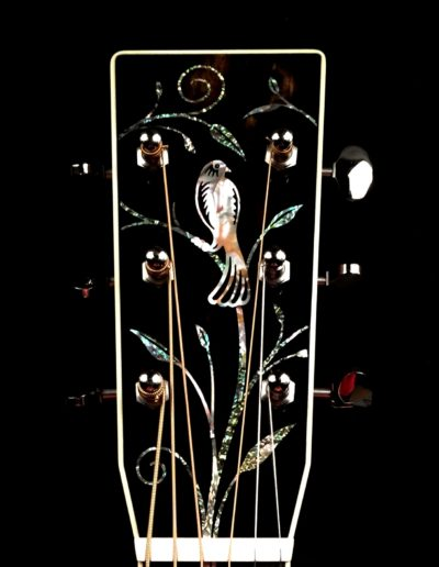 Mother of Pearl songbird with Abalone vines